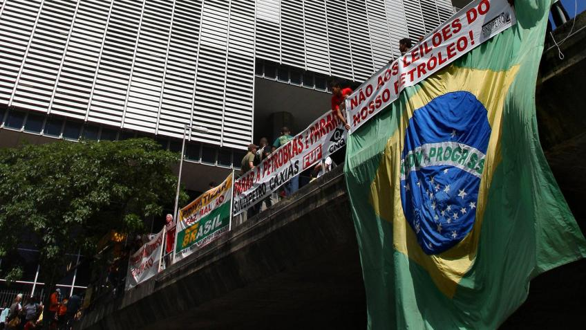 Latin American currencies mostly firm, Brazilian equities hit by Petrobras