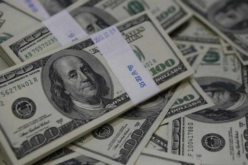 American Dollar gains after dovish ECB report