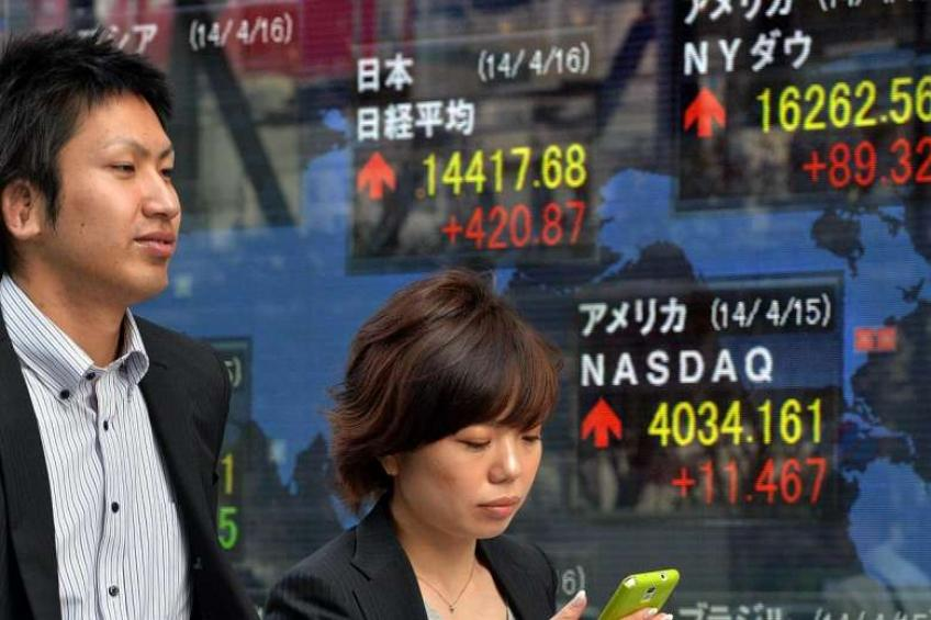 Nikkei ends higher for seventh straight session as yields rise, yen falls