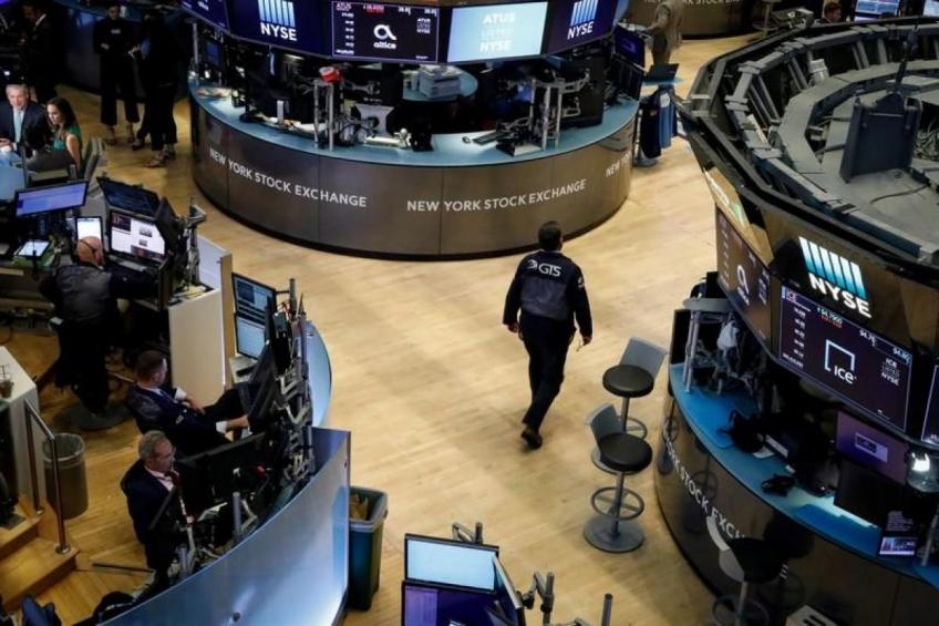 Wall St. ends higher on hopes of interim trade deal, ECB stimulus