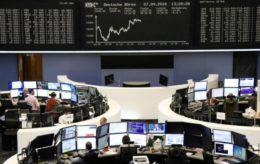 Trade optimism heaves European shares a little shy of two-year peak