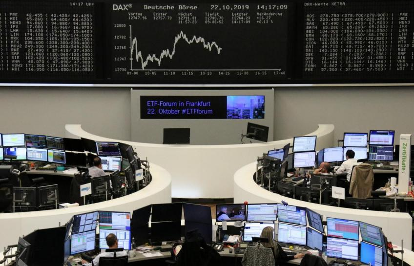 European shares retreat from four-year-peak on Daimler warning, dismal data