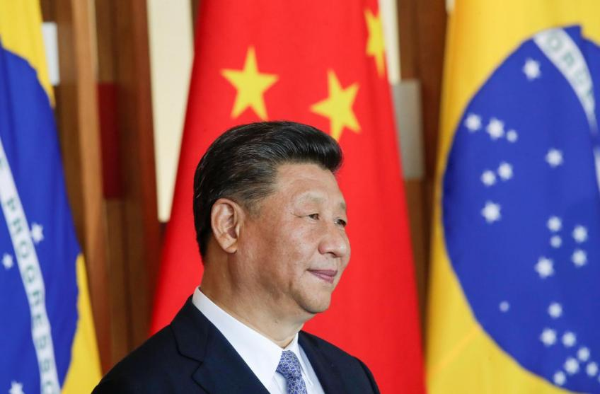 China's Xi says wants to work out an initial trade deal with the US