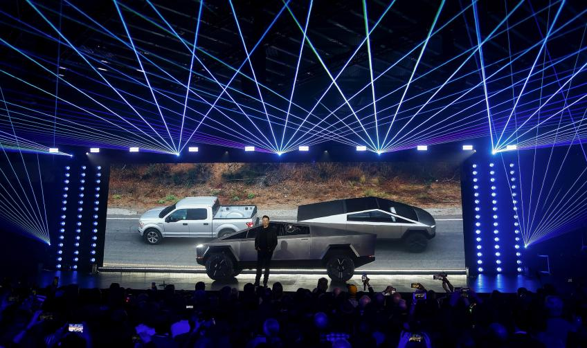 Defying scepticism Musk's Tesla meets Q4 delivery goals, shares cannonball to record