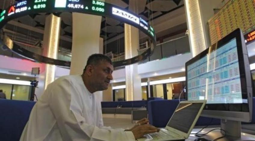 Mideast stocks edge up as Saudi index totters on financials, Aramco