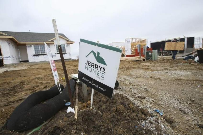 US home building permits near 13-year high, housing starts fall less than expected