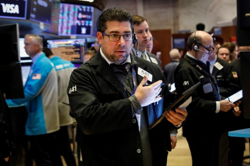 Coronavirus drags down Wall St.; Fed rate-cut hope pares some of earlier losses