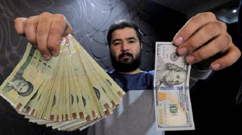 Iranian currency slides to new record lows as US sanctions, pandemic weigh