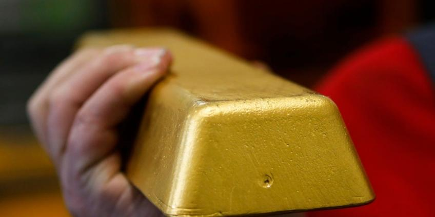 Safe-haven gold futures hit one-week low as upbeat data buoys Dollar