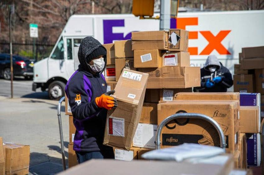 Memphis courier FedEx reports $1.25 billion in profit as business deliveries soar