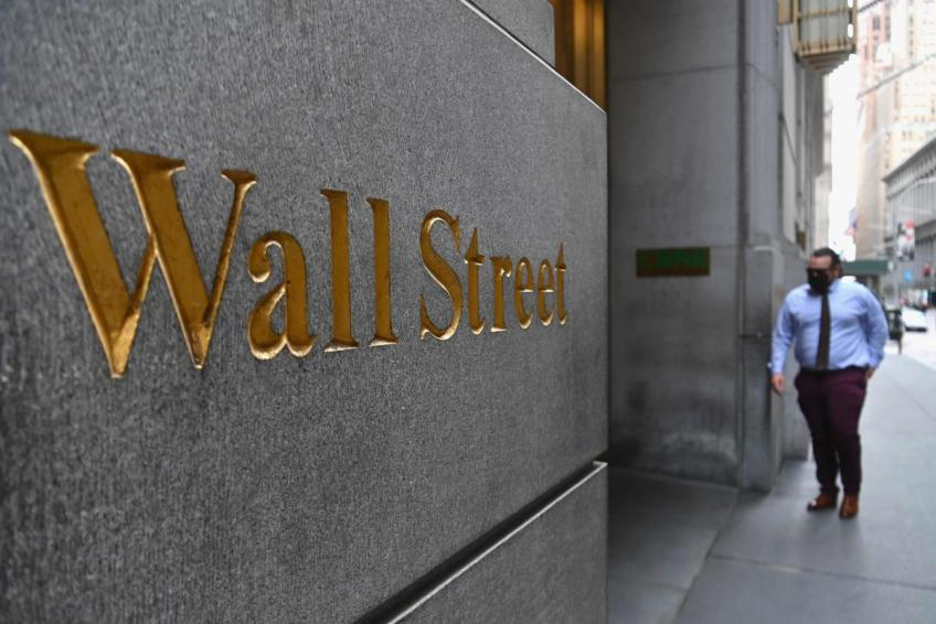 Wall St. sours as tech sell off extends, dismal data stings