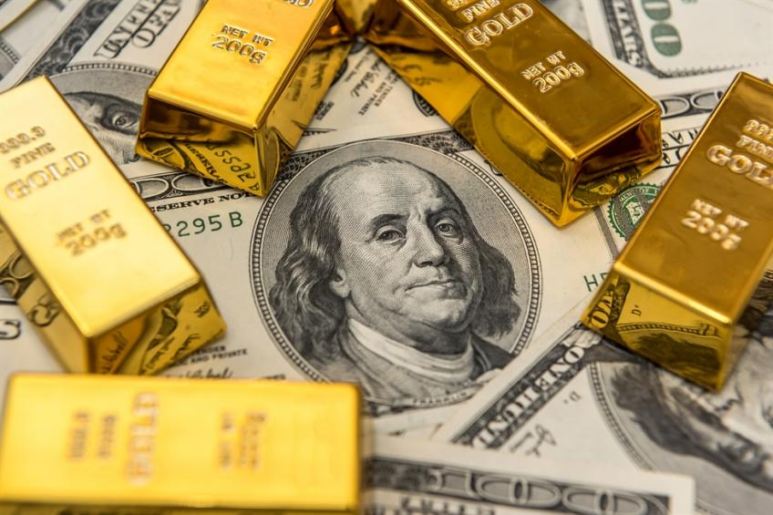 Precious gold slips as investors seek safety on American Dollar amid pandemic hobbles