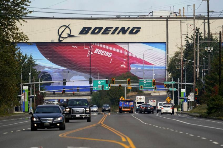 Chicago planemaker Boeing says pandemic will cut demands of plane for a decade