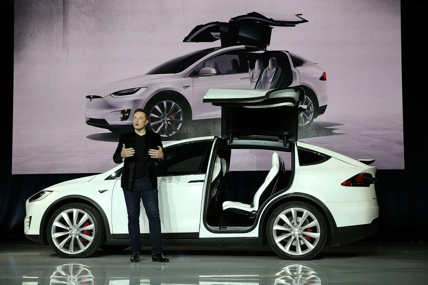 Tesla slashes $2,000 on all vehicles' price tag, shares sour