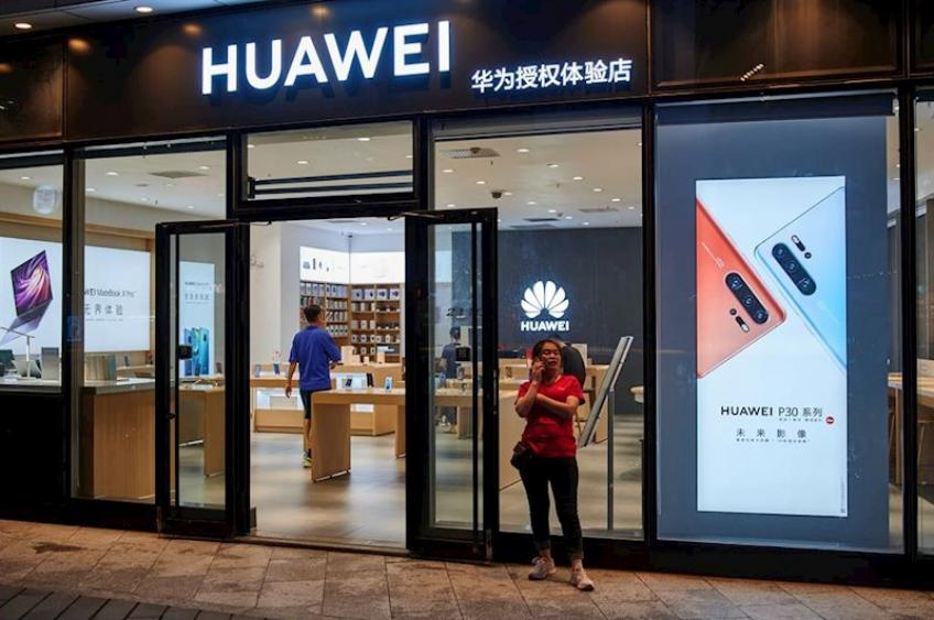 Huawei sales surge, but growth slows amid pandemic, US sanctions