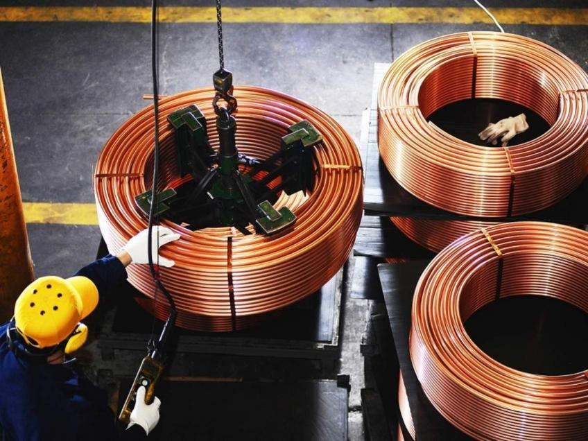 London Copper futures near eight-year peak on demand hopes, decline in inventories