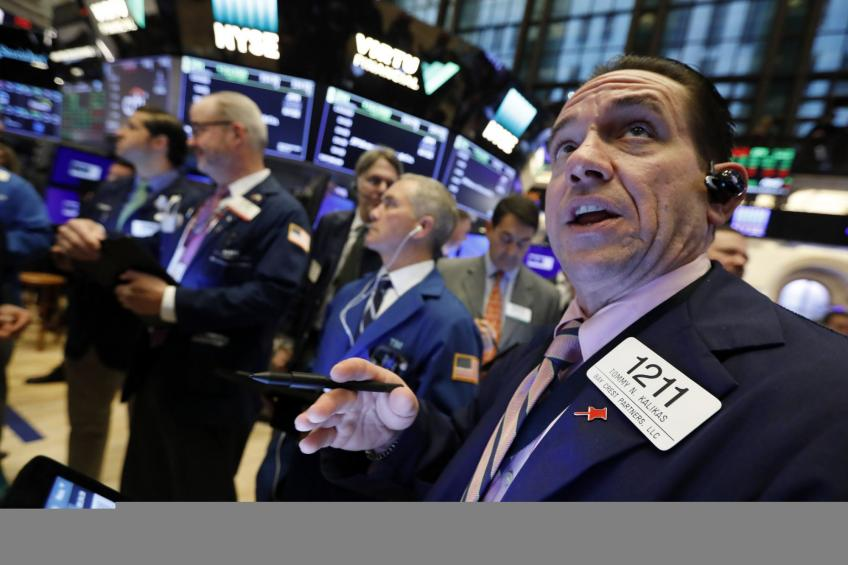 Wall St. closes at record highs as investors downplays stimulus uncertainty