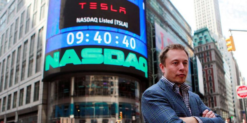 Wall St. falls on renewed pandemic frets; Tesla drops 6.5% in S&P 500 debut