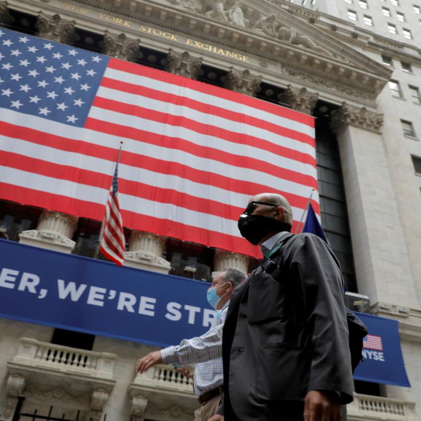 Wall St. pulls back from record levels as additional stimulus uncertain