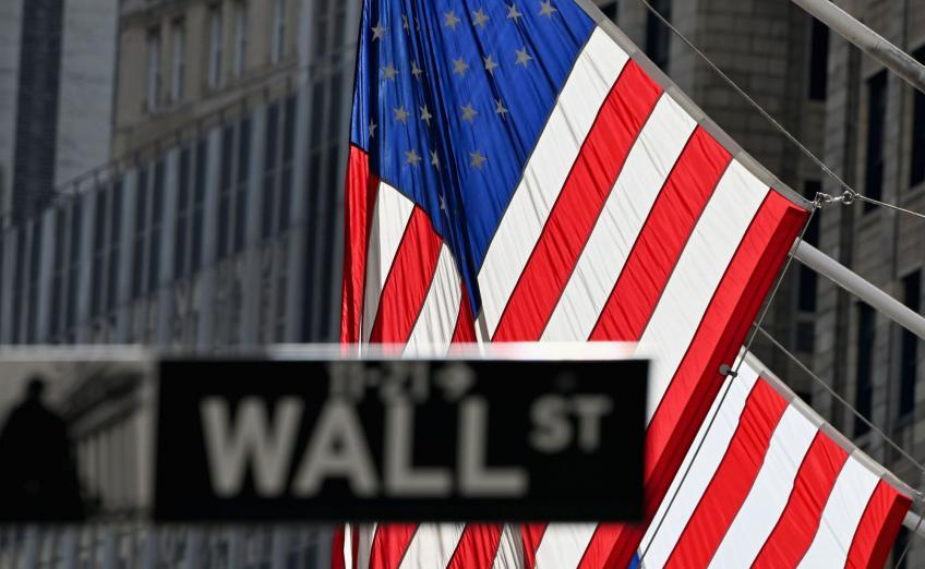 Wall St. ends mixed, scores weekly decline; Facebook leads Nasdaq