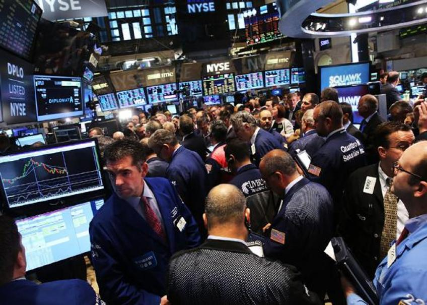 Wall St. reaps lofty gains as Dow ends at record high on upbeat job data