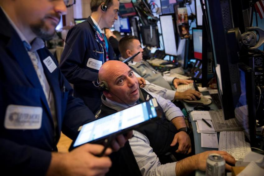Wall St. ends higher, but suffers biggest weekly decline since late-February