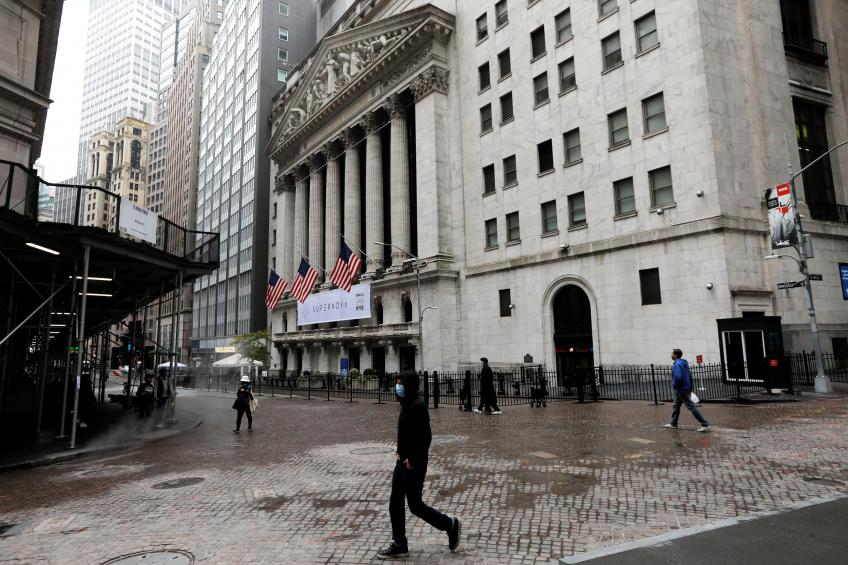 Wall St. tumbles in seesaw session ahead of key inflation data