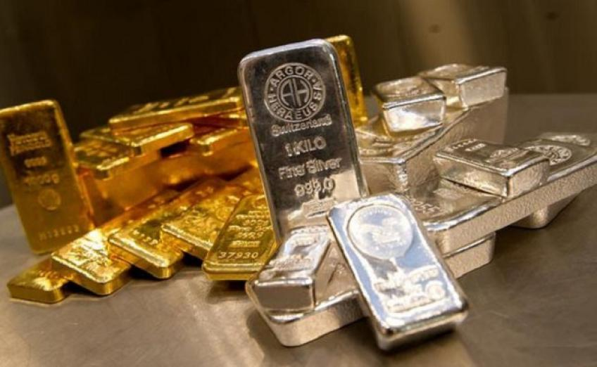 Gold plunges over 2% as post-Fed slide accelerates; US Dollar climbs