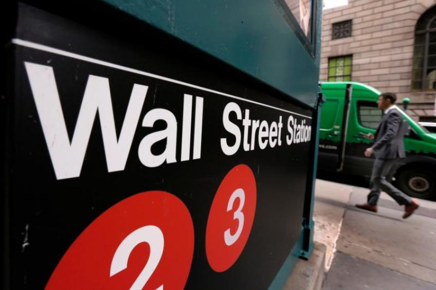 Wall St. ends sharply lower as jobless claims hit 18-month low