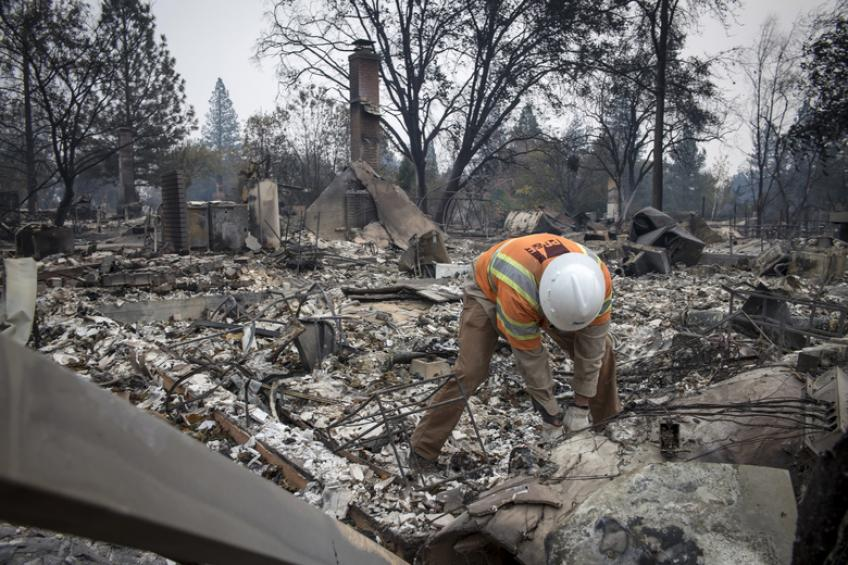 Bankrupted by deadly blazes, PG&E promises to stay on business