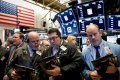 Wall St. in a wobbling trickle after Saudi attacks, energy stocks rise