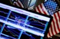 Wall St. treads water after Fed sends mixed signals