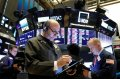 Wall St. ends lower on conflicting trade signs; investors to stay sidelines