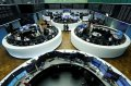 European shares slip on weak earnings, China virus epidemic