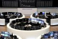 European shares end lower, post weekly plunge amid dismal business activity data