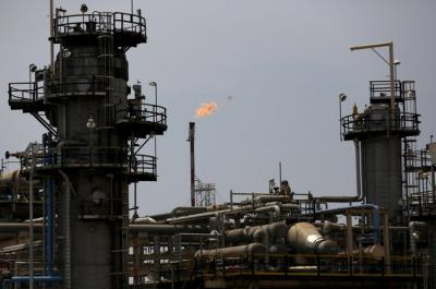 Crude oil rises on upbeat China industrial data, retail sales
