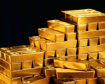 Gold prices take a hit on US dollar hike, banks' stimuli