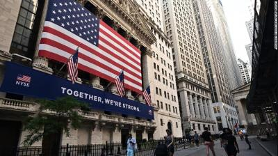 Wall St. inches higher as investors turn to growth stocks